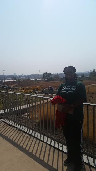Me at the apartheid museum with Jozi in the background